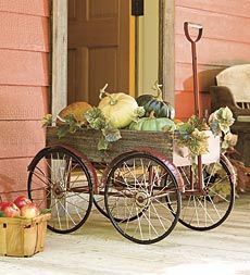 Decorative Vintage Wagon - Plow & Hearth @Stephanie Kaiser  you could pick up a couple old bikes at goodwill and use the tires to make this!!!