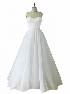 Maddie. Strapless gown with lace bodice fitted to waist & tulle circle skirt, finished with a small buckle detail.