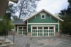 Craftsman Garage with Transom window & Wall sconce | Zillow Digs