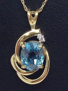 14K YELLOW GOLD 2.5CT BLUE TOPAZ PENDANT WITH DIAMOND ACCENT #Pendant