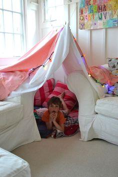 34 Fun Indoor Activities for Kids That Will Cure Cabin Fever kid in blanket fort Indoor Tent For Kids, Indoor Forts, Forts For Kids, Indoor Camping, Living Room Fort, Kids Living Rooms, Sleepover Fort, Cool Sleepover Ideas, Sofa Fort