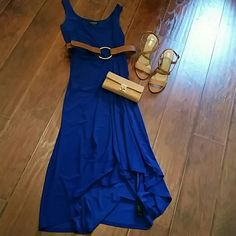 Ralph Lauren Dress Beautiful Royal Blue Ralph Lauren Dress. Ankle length with a suttle high/low hem line Comes with a cute belt.  So pretty when worn with coordinating strappy sandles. (Sandles and wallet not included) Ralph Lauren Dresses