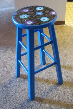 Refinished stool! I got this wooden stool at a thrift sale for $1, spray painted it, and added fabric to the top using Mod Podge. I then sprayed it with acrylic sealer. Cute, unique, and cheap!