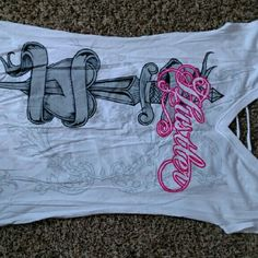 Hustler cutout T-shirt Hustler brand, cutout detailing on back, cap sleeve, never worn (bought to wear on my bike but had to sell bike when found out I was expecting and couldn't wear the shirt!!) Hustler Tops Tees - Short Sleeve
