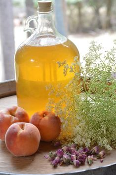 Summer Honey Mead is an easy to make herbal beverage that preserves the summer goodness for winter ills. Old timers preserved herbs in many ways to get through the long winter months of ice and snow. Honey mead is a refreshing vehicle for herbs. Honey Mead, Wine Corker, Grape Juice Concentrate, How To Make Mead, Mead Recipe, Peach Wine, Honey Wine, Homemade Liquor, Winter Cocktails