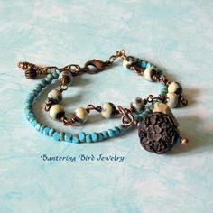Boho Jewelry, Beaded Bracelet, Elaine Ray Ceramic, Glass, Wood Beads, Copper Blue Brown White. $38.00, via Etsy.