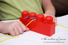 I saw this activity (see here) and loved the idea of teaching flossing by using legos and playdough so that is what we did!  :)  Lots of other cute stuff on the same site!