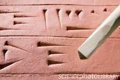 We could do cuneiform writing on crayola model magic compound (terra cotta color)  with a stylus.  Print the alphadet diagram and let the children practice.