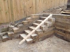 Railway sleeper steps and retaining walls