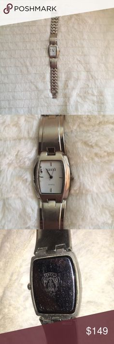 Authentic Gucci watch Fabulous watch! Not cracks in glass! Does need a battery and there are minor scratches from wear on the watch but once you put a battery in this watch it will be superb! Gucci Accessories