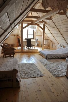 Cottage Guest Bedroom with Daybed, Shag area rug, Lace valance curtains, Exposed beam, Wicker furniture