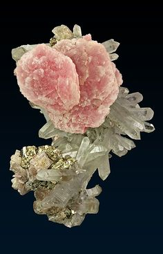 pyrite on quartz - pink stone could be rhodochrosite