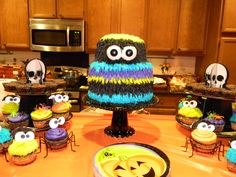 A monster cake with monster cupcakes!