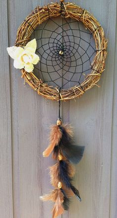 Handmade dreamcatcher with a woven frame hamsa by VenusAurora, £15.00