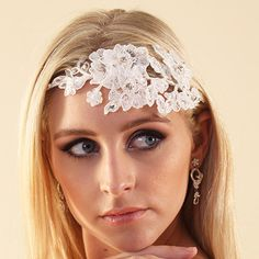 Embroidered lace headband with diamante and pearl detail. Presented in Roman