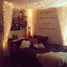 Cute bedroom: Fairy lights around a four poster bed with quote on the wall