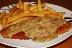 This is a classic German dish: German Jaegerschnitzel Hunter Style as we make it in Germany. You can easily make it at home without traveling to Germany!