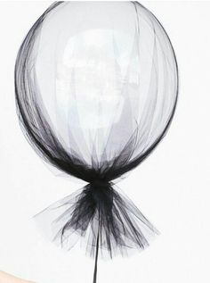 Tulle covered helium balloon