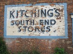 Ghost sign for Kitching's South End Stores, South End, Thorne. This grocery shop was open until 2008 or 2009.