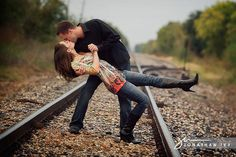 Google Image Result for http://jonathanivyphoto.com/blog/wp-content/uploads/2010/12/railroad-tracks-kissing-engagement-photo-1.jpg