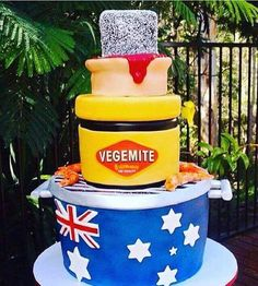 Australian Birthday cake, a barbecue cooking prawns, jar of vegemite, meat pie topped with a leamington.
