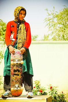 One of Afghanistan's first female skateboarders, Fazila, waits to skate on a mini ramp in Kabul