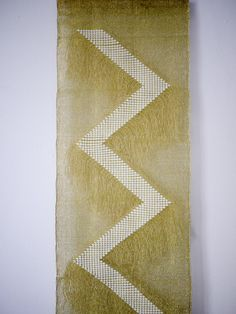 Textile weaving tapestry by artist Justine Ashbee. Golden Zag. Woven metallics. NativeLine Native Line by Justine Ashbee wall hanging