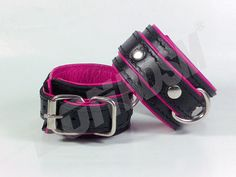 """These high quality hand crafted restraints cuffs ensure that you or your partner are under control! These premium genuine leather restraints are 1 5/8 inches wide and reinforced with four layers of leather.    Features:    1) Ideal to control and restraint!  2) All studs are covered by leather to protect your skin.  3) Premium D rings and fittings.  5) Measures approx. 10 3/4' (27cm"""") total length and 1 5/8' (4cm"""") in width.  6) Fits wrist size 5 1/2' inches (14 cm"""") to 7.5' inches (19cm"""")…"""