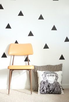 Apartment living triangle wall. Cut triangles out of contact paper and apply to wall. No painting needed