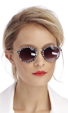 Rounded wayfarer sunglasses with tiny daisies printed along the frames