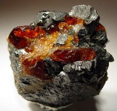 Red gem-like crystals of Chondrodite with magnetite, Tilly Foster mine, Brewster, New York USA