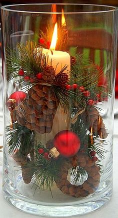 Christmas - simple but beautiful clear vase or storm-lantern arrangement ... use conventional or LED candle