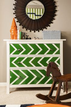 Green painted dresser in the #nursery - and love the mustache drawer pulls!