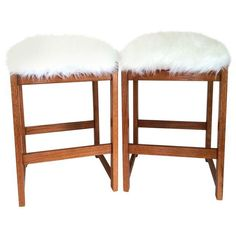 A gorgeous pair reupholstered in brand new Safavieh faux sheepskin.