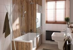 Both a luxurious bath and a luxurious shower, even in a small bathroom? It is possible This HSK shower room is beautifully finished and offers the luxury of bathing and showering. Bathroom Wall Decor, Bathroom Interior Design, Bathroom Ideas, Room Divider Shelves, Armoire Makeover, Small Bathroom Storage, Bathroom Renovations, Amazing Bathrooms, House Design