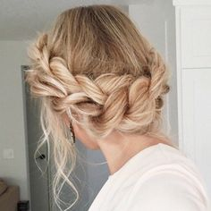 Stunning braided crown hairstyle on blonde hair.  This braid is a difficult braid to do, but once you learn it you will love to wear this hairdo to all your formal events.