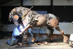 John Lopez works on Black Hawk, a scrap iron sculpture of a life-size plow horse pulling a single bottom plow