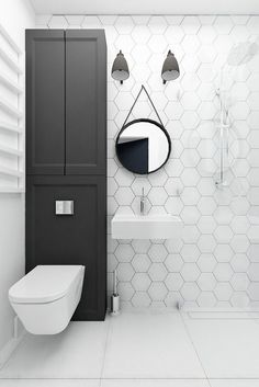 floating loo - with storage above - lighting simple mirror - white tiling to ceiling - modern fixtures big floor tiles - SIMPLE UNFUSSY