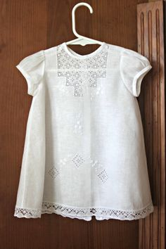 When welcoming our little girl to her new home we want her to look beautiful and feminine. This lovely piece, is adorned with the best bobbin lace
