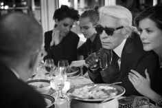 Annie Clark, Cara Delevingne, Karl Lagerfeld, and Virginie Mouzat @ the Vanity Fair France + Chanel dinner in Golfe-Juan, France  Photographed by Mark Seliger