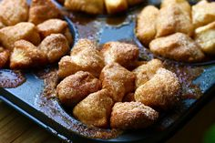 Individual Monkey Bread  3 cans biscuits-not flakey  1 1/2 c sugar mixed with 2-3 tsp cin  Quarter biscuits and drop into cin/white sugar mix in ziploc  Melt 1/2 c br sugar and 2 sticks butter, pour over cin sugar biscuits.  Bake on 350 @ 15-20 min.
