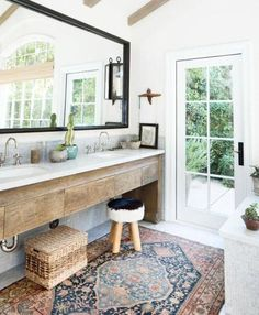 Boho vanity a rough wooden vanity baskets and some potted plants plus a rug Boho Bathroom, Diy Bathroom Decor, Bathroom Rugs, Small Bathroom, Bathroom Ideas, Master Bathroom, Bathroom Inspo, Bath Decor, Bathroom Inspiration