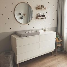 I'm loving the neutral gray in this nursery room. The extra details on the wall . I'm loving the neutral gray in this nursery room. The extra details on the wall and on the floor, makes this a really welcoming room for both parents and child.