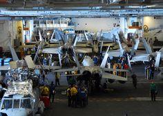 the hangar bay aboard the aircraft carrier USS Ronald Reagan (CVN 76)
