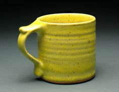 Oak Bluffs Pottery - Glossy Yellow Thumbrest Mug via Etsy.