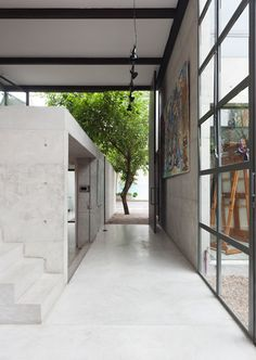Rooms are housed within stark concrete boxes at this São Paulo artist's studio.