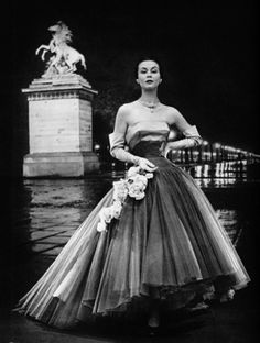 An evening gown in Paris, 1951. I love the lighting of the city here.