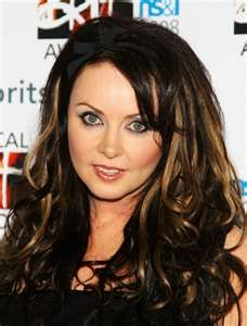 Sarah Brightman One of my favorite singers not to mention she is beautiful :) and has an amazing voice :) <3