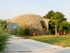 Brigham City, Utah — This small Monolithic dome home with a stone textured shell is 800-square-feet and visually spectacular! No A/C is needed and the windows are opened at night to cool it. It stays cool all day. The owner did the rock cover on the exterior herself.— www.monolithic.com