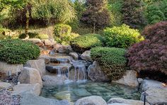 Flowing water feature river to pond in Asian garden